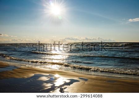 Beautiful Sunset over Baltic Sea Beach. - stock photo