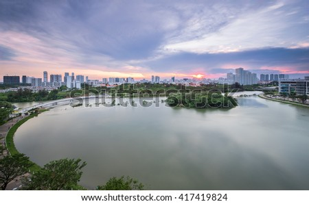 Beautiful sunset over Ban Nguyet Lake with starlight bridge by the weekend, the central of Phu My Hung, District 7 (new urban/city area Ho Chi Minh City, Vietnam)