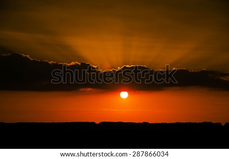 Beautiful sunset over field - stock photo