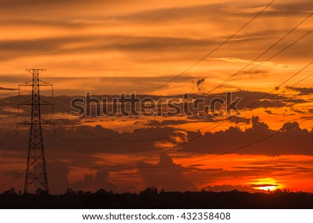 Beautiful sunset over high electric pole landscape - stock photo