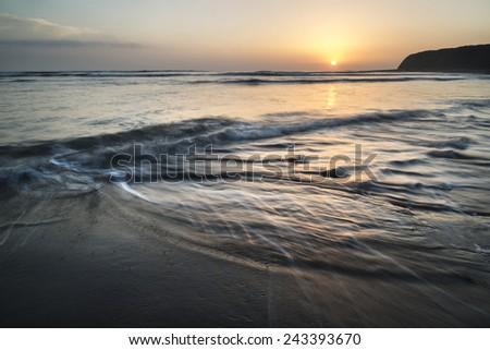 Beautiful sunset over Kimmeridge Bay Jurassic Coast England - stock photo