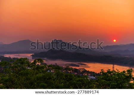 Beautiful sunset over lake in Luang prabang, Laos. - stock photo