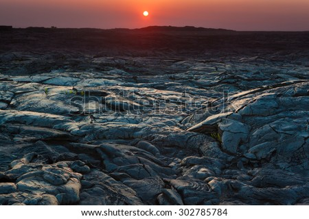 Beautiful sunset over molten cooled lava landscape in Hawaii Volcanoes National Park, Big Island, Hawaii