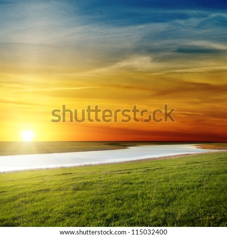 beautiful sunset over river - stock photo