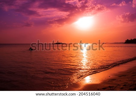 Beautiful sunset over sea with sun reflection - stock photo