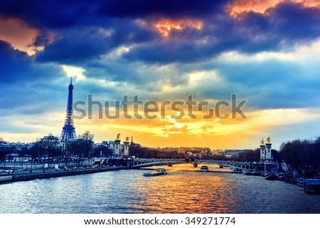 Beautiful sunset over Seine river and Alexandre III bridge. Paris, France. Cityscape background - stock photo