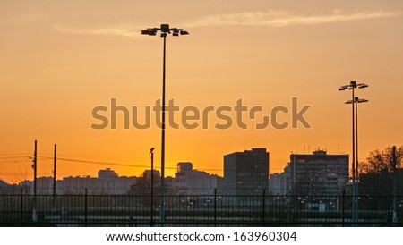 Beautiful sunset over skyline with street lamps. Moscow, Russia.