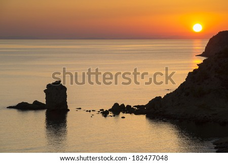 Beautiful sunset over the Mediterranean sea at the island of Thassos, Greece. - stock photo