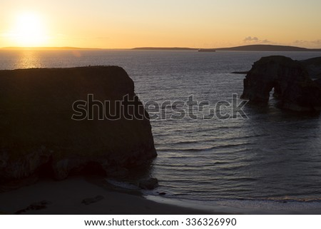 beautiful sunset over the nuns beach and virgin rock on the wild atlantic way - stock photo