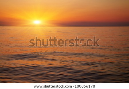 Beautiful sunset over the ocean. Sunrise in the sea  - stock photo