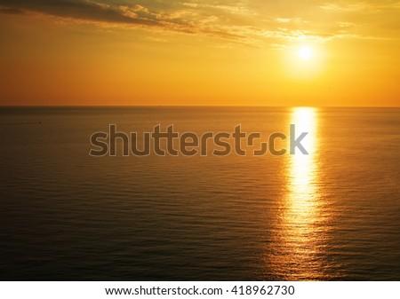 Beautiful sunset over the ocean. Sunrise in the sea - stock photo