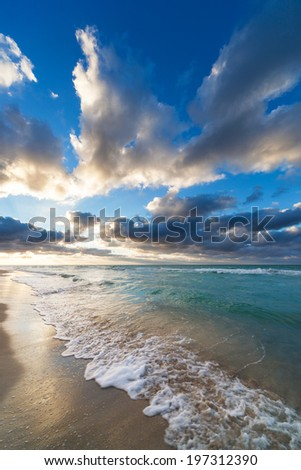 beautiful sunset over the sandy beach - stock photo