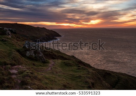 Beautiful sunset over the sea, high point of view. Photo taken in Cornwall, England.