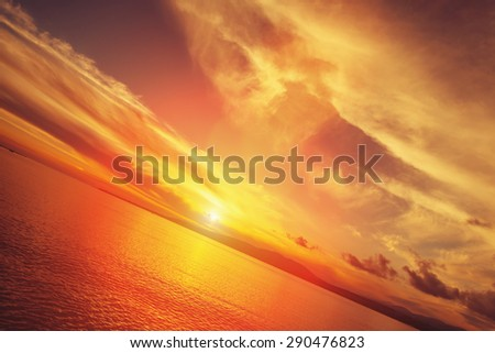 Beautiful sunset over the sea in red and yellow colors