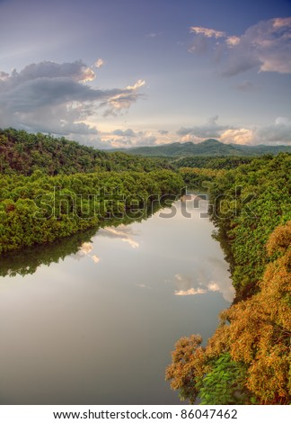 beautiful sunset over tropical river - stock photo