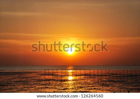 Beautiful sunset scenery from the seashore - stock photo