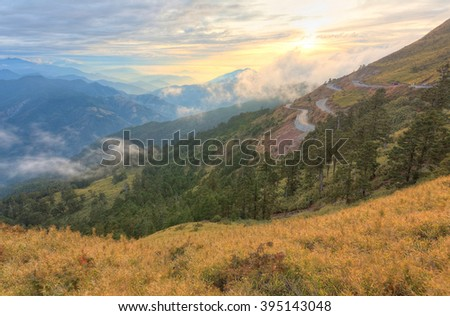 Beautiful sunset scenery with a mountain highway curving high up in Taiwan's Alpine Range leading to Hehuan Mountain on the boundaries of Nantou and Hualien counties, in Taroko Gorge National Park. - stock photo