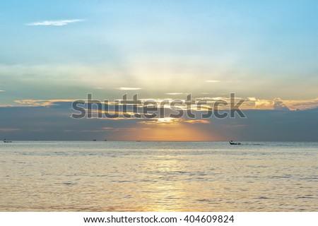 Beautiful sunset sky and calm sea water. Summer sea sunset, Karon beach, Phuket, Thailand. Calm sea at sunset, Thailand. Sunset reflection in sea. Pastel sunset with sun beams. Soft sunset, Phuket.  - stock photo