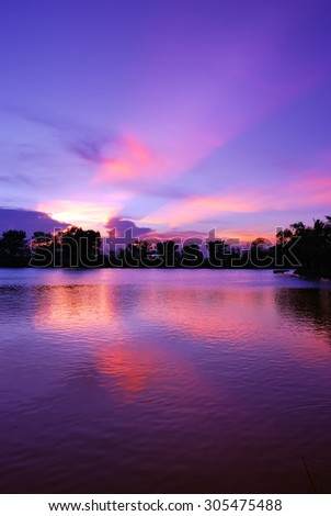 Beautiful sunset sky and light ray - stock photo