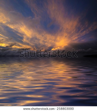 beautiful sunset sky and water level - stock photo