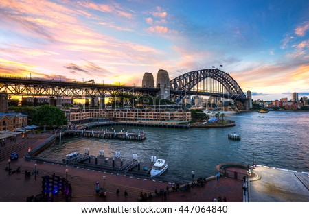 Beautiful sunset sky over sydney harbour bridge view from oversea ship terminal near The Rock  - stock photo