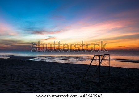 beautiful sunset sunrise background on the beach with silhouette small in the foreground