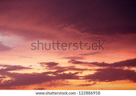 Beautiful Sunset / sunrise with clouds, in pink and purple shades - stock photo