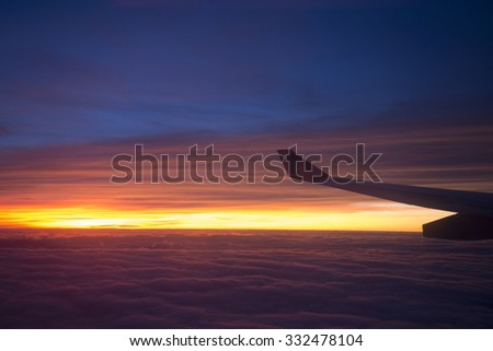 Beautiful sunset,view from out of the airplane window - stock photo