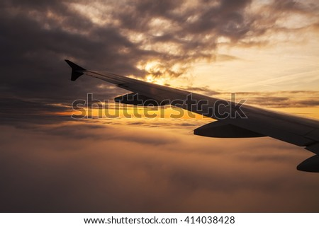 Beautiful sunset. View from the plane window - stock photo