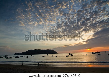 Beautiful sunset view of Salango island surrounded by fishing boats in Manabi, Ecuador - stock photo
