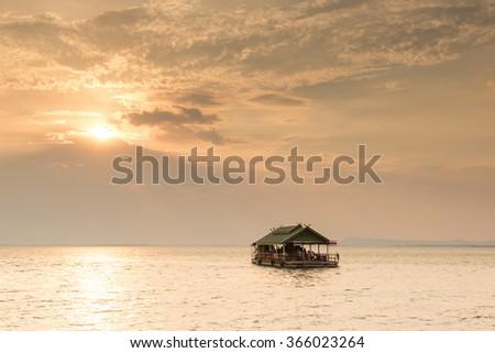Beautiful Sunset whit Raft in UbolRatana Dam , khon kaen, Thailand - stock photo