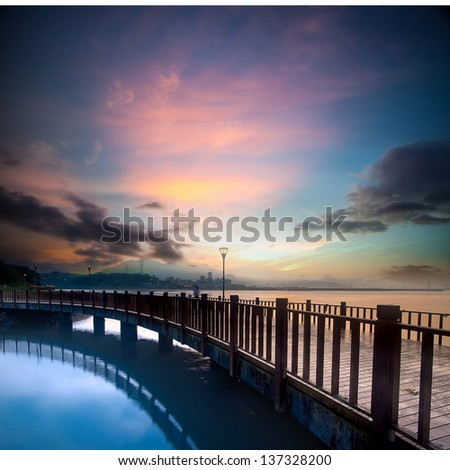 beautiful sunset with a bridge over for adv or others purpose use - stock photo