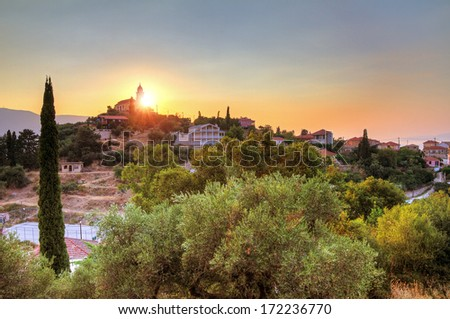 Beautiful sunset with a church on top of the hill on Zakynthos, Greece. HDR
