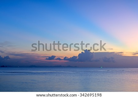 Beautiful sunset with blue sea and sky background - stock photo