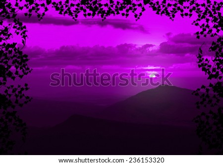 Beautiful sunset with cloud and mountain,tree foreground siluette frame,purple color tone - stock photo