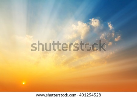 beautiful sunset with light rays  - stock photo