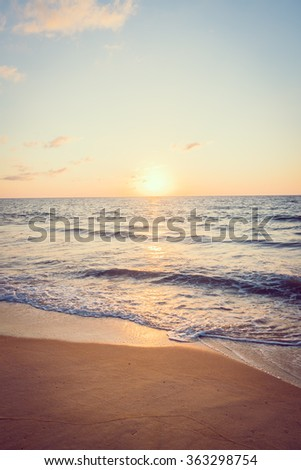 Beautiful Sunset with sea and beach - Vintage and sunflare filter effect
