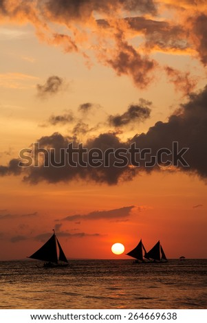 Beautiful sunset with yachts at Boracay, Philippines - stock photo