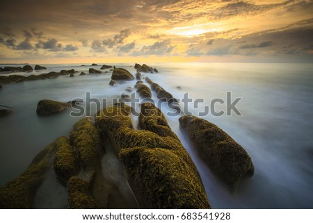 Beautiful Sunsets over the sea rock formations at Kuala Penyu, Sabah, Borneo