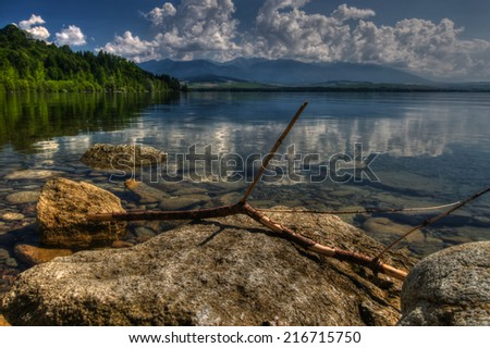 Beautiful sunshine montains and lake scenery - stock photo