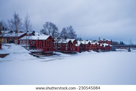 Beautiful super panoramic winter aerial christmas new year view of scandinavian city with scenery beyond the city and beautiful old red wooden warehouses sheds  - stock photo