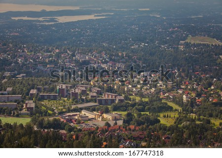 Beautiful super wide-angle aerial view of Oslo, Norway with  and scenery beyond the city, seen from the observation tower of Holmenkollen Ski Museum