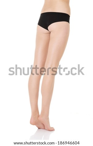 Beautiful supple and smooth woman's buttocks and legs. Isolated on white.