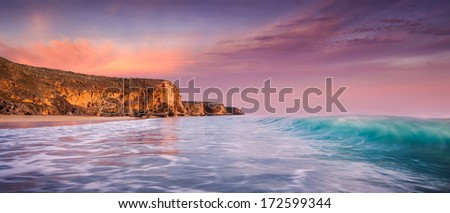 Beautiful surf beach at sunset - stock photo