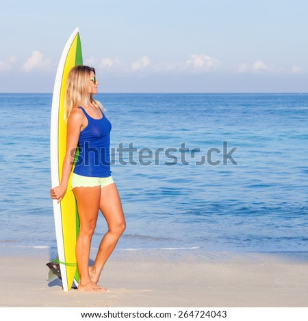 Beautiful Surfer Girl on the Beach at the day time