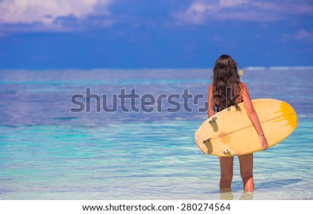 Beautiful surfer woman surfing during summer vacation - stock photo