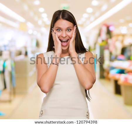 Beautiful Surprised Young Woman at a mall - stock photo