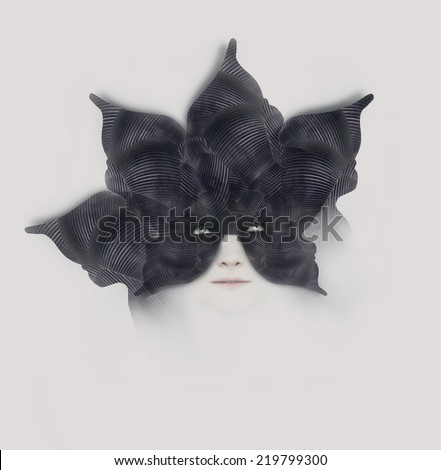 Beautiful surreal artistic portrait of a female with a bizarre black mask-hat shaped with like a flower with petals on white background - stock photo