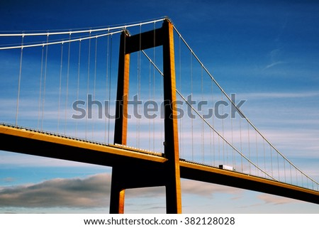 Beautiful suspension bridge with one truck. Blue and cold  day in Fredericia,  Denmark - stock photo