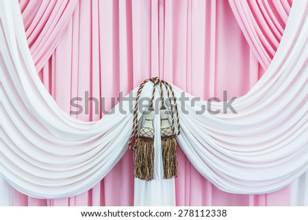 Beautiful sweet curtains with tassels,texture for background. - stock photo